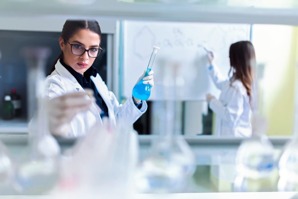 Female scientist in a biotech lab