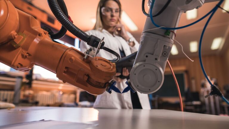Scientist working on a robotic arm